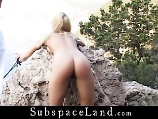 Blonde pimp tied by a sea cliff and fucked by her dom male