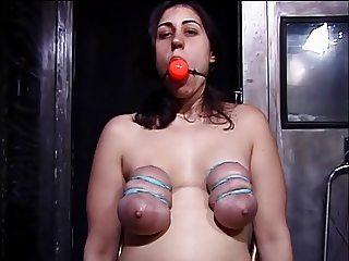 Big tits hottie gagged and enjoying a BDSM session