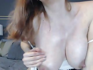 Milky redhead gets naughty