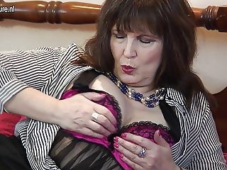 Classy granny rubs her clit and cunt