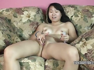 Shy coed Jaylynn stuffs a toy in her hot Asian twat
