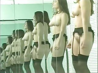 Busty brunette strips in front of mirror