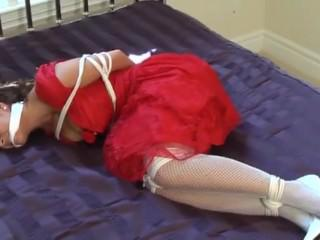 Bound and gagged on the bed