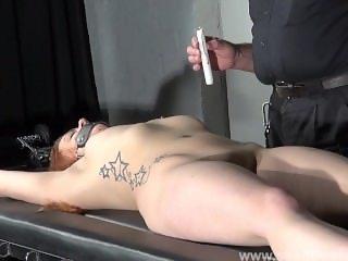 Amateur slave Louise in dungeon rack bondage and hot wax tit punishments