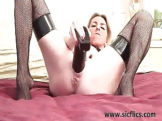 Busty blond fucking huge bottles and dildos