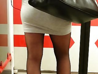 Tight miniskirt and Black pantyhose.