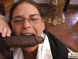 Sexy MILF in glasses deepthroats an enormous black cock