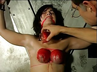 Bound hottie with gigantic boobs gets her boobs covered in candle wax