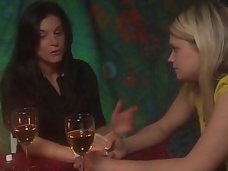 A Pretty Blonde is seduced by a Sexy Brunette Woman.