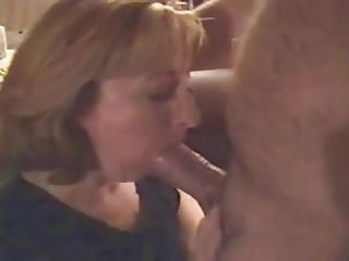 Horny housewife deepthroats hubby's thick cock friend