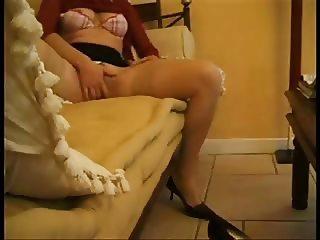 Masturbates in Hold Ups on Sofa