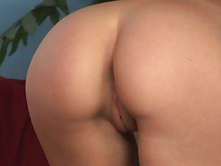 Fresh faced blonde Kitty masturbates solo on the sofa