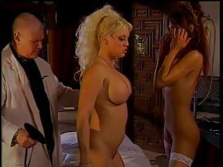 Horny doc in spanking action with 2 big tit hotties