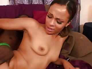 Ebony sex on sofa