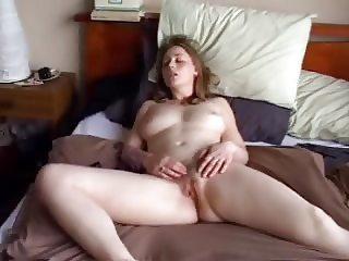 Masturbates to orgasm on a bed