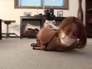 Lady tied and gagged on floor