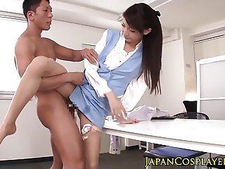 Uniformed asian CFNM babe loves sucking two cocks