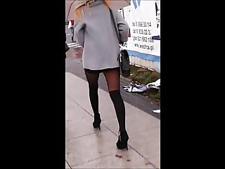 Girl with sexy legs in mini skirt and nice pantyhose