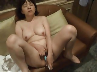 Horny Japanese milf  Kui Somya  toying on the sofa 2