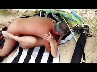 His wife with stranger at the beach