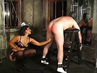 Hot looking mistress Delilah spanks her bent-over slaves ass