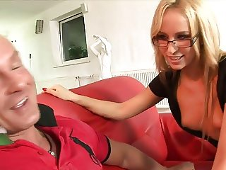 Hot blonde in stockings and glasses gives stud a foot job