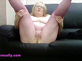 Mature Sally bald pussy in fishnet tights
