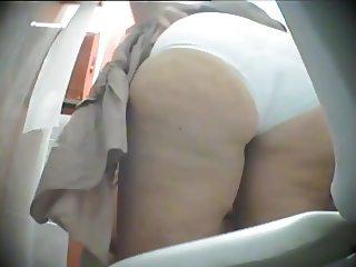 Blonde BBW spied using public toilet