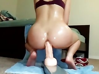 Moaning while playing with her ass
