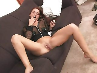 Slutty Ameara rubs her her pussy with her leather belt on the sofa
