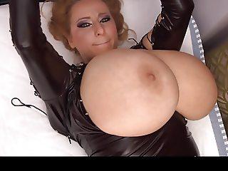 Huge fat boobs in a tight black dress