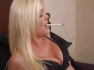Blonde Smokes In Bed