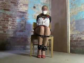 Lady in Leather Armbinder, gagged and hooded