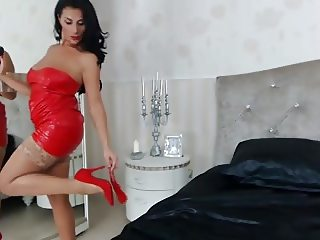 Raven Haired Milf In Red Leather Teases