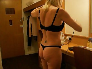 mature blonde in a thong and bra
