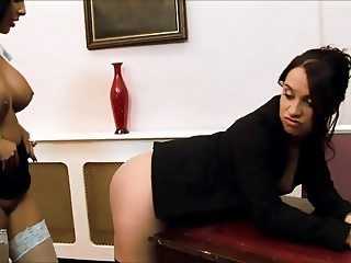 Naughty lesbos in stockings have sensual dildo fuck in an office