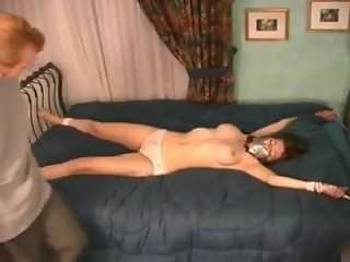 House wife tied to a bed
