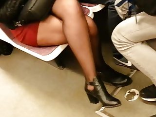 Sheer black pantyhose boots and miniskirt.