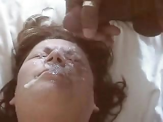 Emptying a good load on the wife's face