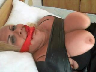 taped up and gagged on bed