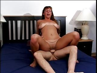 Sexy young brunette gets her lips around a big white cock to suck