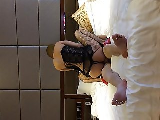 Chinese amateur DJ with fishnet stockings