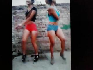 Two latina teens dancing