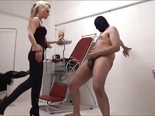 Blonde mistress tortures slave balls