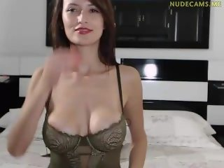 Busty brunette from nudecams.me show striptease on webcam
