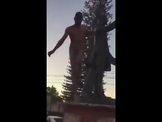 Naked guy humping statue in public