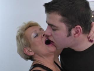 Mature hotel maid catches a young jerking in the room