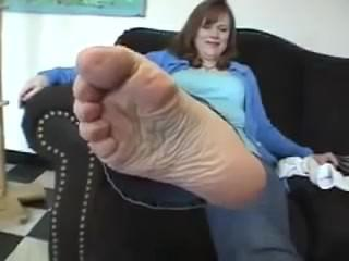 Mature feet straight out of shoes and white gold toe socks