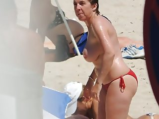 Granny caught topless at the beach