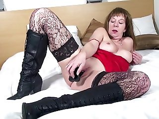 Dirty granny in black stockings and high leather boots